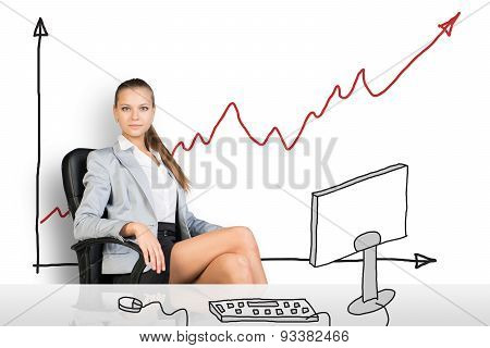 Businesslady sitting half-turned at drawn table