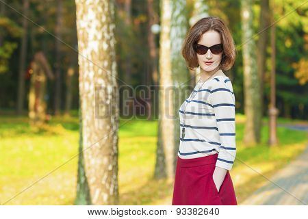 Fashion Trends And Style Concepts: Caucasian Brunette Woman Posing In Autumn Forest