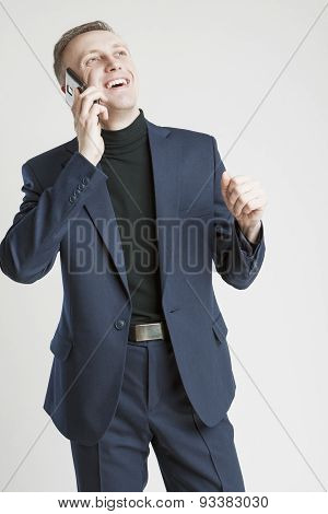 Portrait Of Caucasian Businessman In Stylish Blue Suit Speaking By Cellphone With Positive Facial Ex