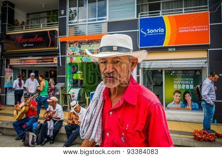 Unidentify indigenous man that works coffee plantation shopping in the main commercial street of Arm