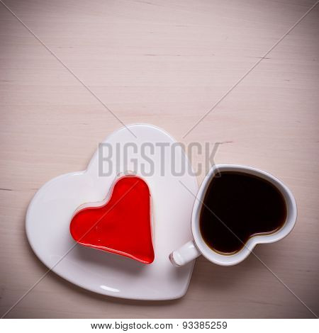 Heart Shaped Coffee Cup And Cake On Wood Surface