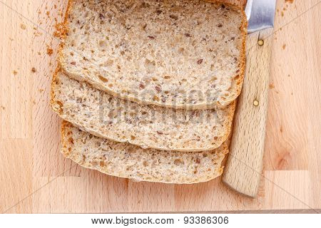 Sliced Wholemeal Bread On Cutting Board