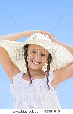 Portrait Of Happy Girl In A White Hat