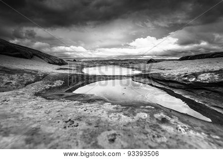 Stormy Sky Puddles Of Water After Rain Utah Landscape