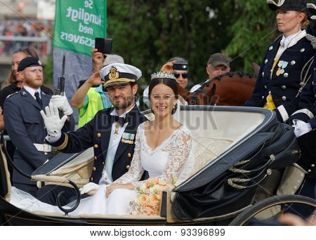 Front View Of Swedish Prince Carl-philip Bernadotte And His Wife Waving And Smiling