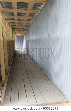 Industrial Walkway In Wood And Corrugated Tin