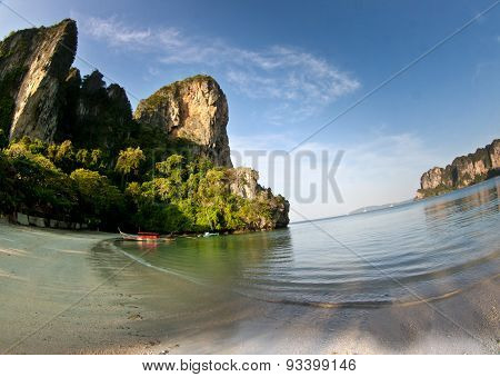 Long Tail Boat  At The Beach In Railay Beach Thailand And Rock In The Background
