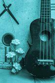 pic of ukulele  - Ukulele and clock on a black and white background - JPG