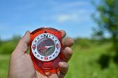 stock photo of compasses  - Compass in hand - JPG