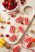 stock photo of popsicle  - Homemade Strawberry and Banana Popsicles on a Stick - JPG