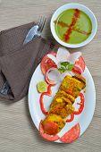 image of paneer  - Tasty Cottage cheese or Paneer tikka on white plate - JPG