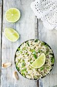 stock photo of cilantro  - cilantro lime garlic brown rice on wooden background - JPG
