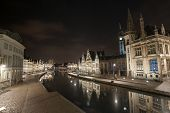 pic of gents  - The historical buildings of Gent in Belgium at night with reflections in the river Scheldt