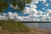 pic of windy  - Cloudy and windy September day on the beach of the lake - JPG
