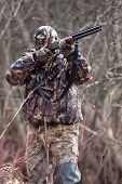 foto of hunter  - the hunter in camouflage with a gun - JPG