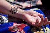 picture of mehendi  - black henna tattoo mehendy on hand mandala - JPG