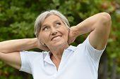 picture of beautiful senior woman  - Happy beautiful senior woman in the summer park - JPG