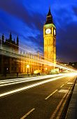 stock photo of london night  - Big Ben one of the most prominent symbols of both London and England as shown at night along with the lights of the cars passing - JPG