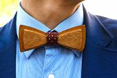 stock photo of coat tie  - Fashionable wooden bow tie closeup - JPG