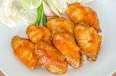foto of bbq food  - BBQ Chicken Wings on white dish  - JPG