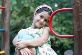 picture of playground school  - Cute girl smiling and sitting on school playground - JPG
