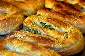 picture of phyllo dough  - Balkans pastry borek on display in a bakery food background and texture  - JPG