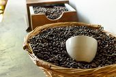 pic of coffee coffee plant  - roasted coffee beans in brown basket soft focus focus on coffee - JPG
