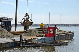 stock photo of dredge  - Dredging a Michigan marina with crane - JPG