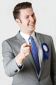 foto of politician  - Studio Portrait Of Untrustworthy Politician Winking At Camera  - JPG