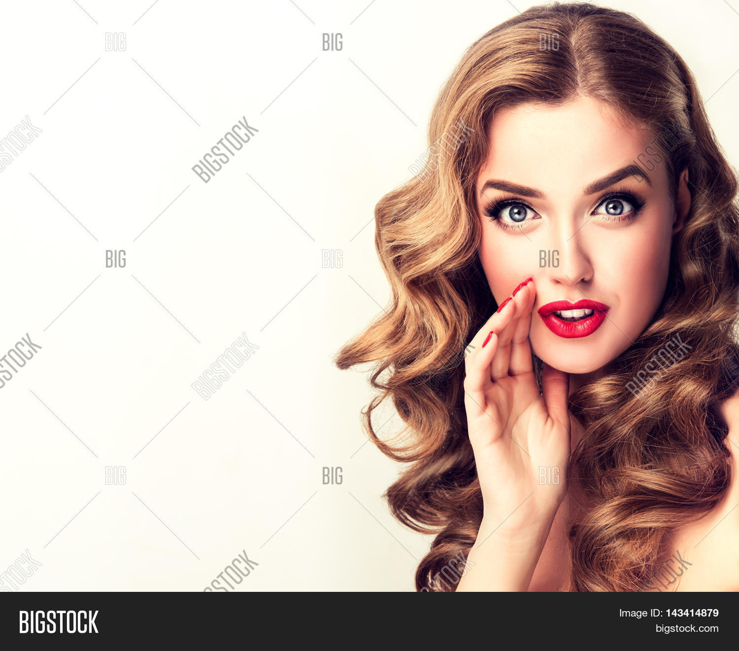 Beautiful Girl With Bright Makeup And Curly Hair Telling A