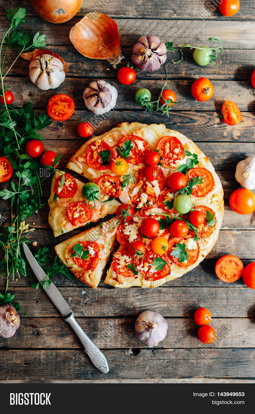 Veggie pizza with tomatoes shallot and fresh herbs