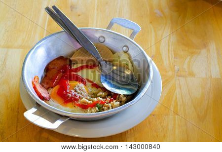 Indochina pan-fried egg with toppings Thai styleegg pan / cooking egg pan concept Close up