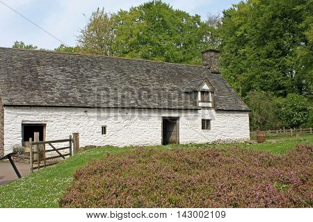 Ancient stone farmhouse building in rural Wales