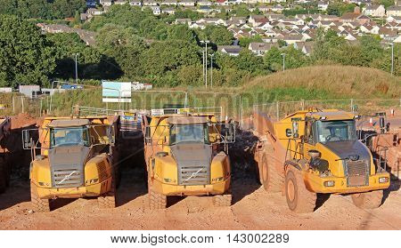 Dump trucks on a road construction site