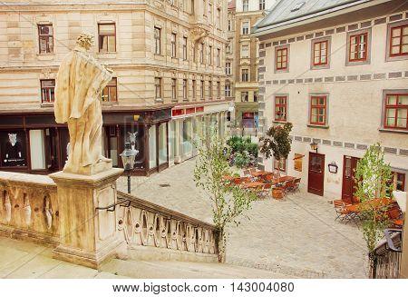 VIENNA, AUSTRIA - JUN 10, 2016: Old area of Vienna with sculptures of christian churches on June 10, 2016. Vienna has population near 1.8 million