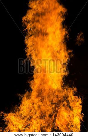 Fire flames on a black background. Blaze fire flame texture background. Close up of fire flames isolated on black background.