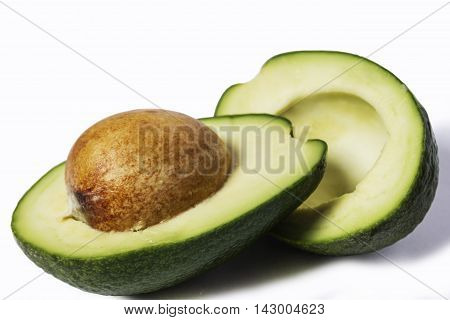 Two slices of avocado isolated on a white background. One slice with core. Design element for product label catalog print web use.