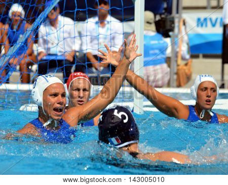 Budapest, Hungary - Jul 16, 2014. DI MARIO Tania (ITA, 7) the captain of Italy defending against french players. The Waterpolo European Championship was held in Alfred Hajos Swimming Centre in 2014.