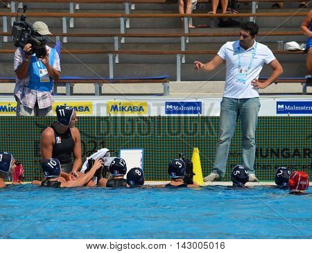 Budapest, Hungary - Jul 16, 2014. France's SAKELLIS Filippos head coach talking about the tactics. The Waterpolo European Championship was held in Alfred Hajos Swimming Centre in 2014.