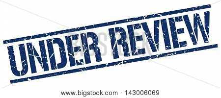 under review stamp. blue grunge square isolated sign