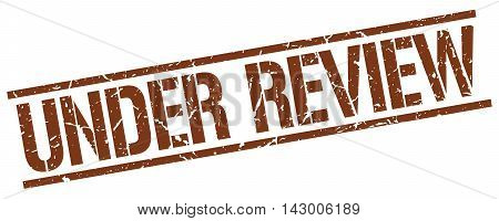 under review stamp. brown grunge square isolated sign