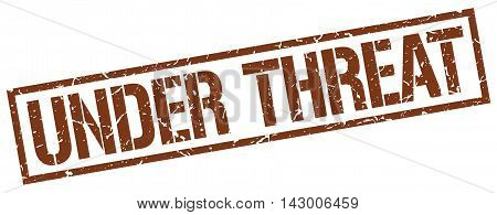 under threat stamp. brown grunge square isolated sign
