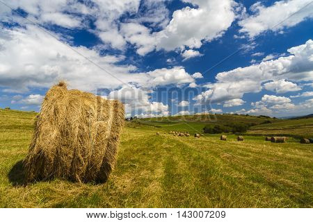 A Harvest Landscape Vista In Rolling Hills In Romania With Round Straw Bales And Patchwork Fields Un