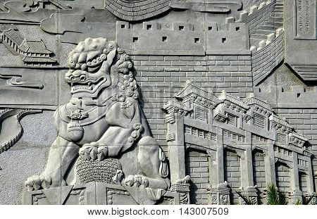 Changping China - May 2 2005: Bas relief carving of a Fu Dog and Gate of Heaven Ceremonial Gate at the Ming Dynasty Tombs Historic Site museum