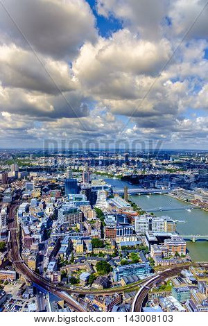 Aerial view of the city of London UK and the River Thames showing the topography on a cloudy blue sky day in a travel and tourism concept