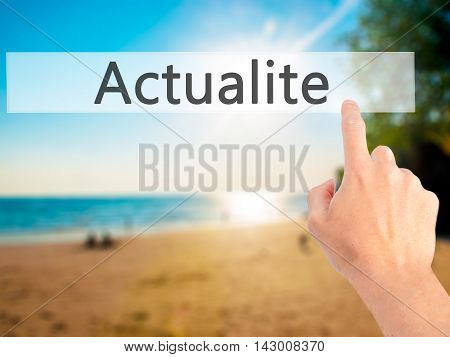 Actualite (news In French) - Hand Pressing A Button On Blurred Background Concept On Visual Screen.