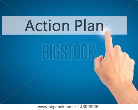 Action Plan - Hand Pressing A Button On Blurred Background Concept On Visual Screen.