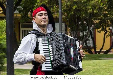 SELARGIUS, ITALY - September 13, 2015: Former marriage Selargino - Sardinia - accordionist of the folk group