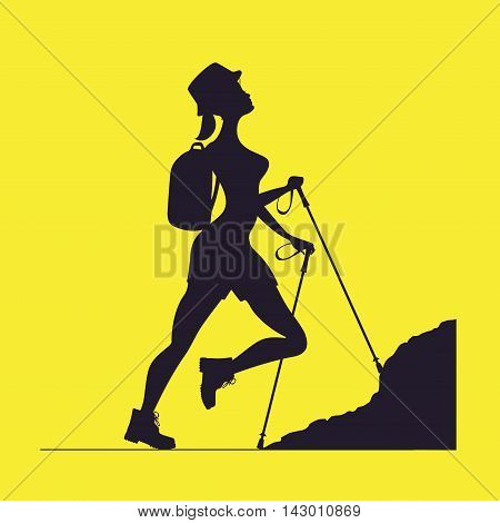 Woman traveling in the mountains.Tourist rock-climber with a backpack. Orientation to districts.