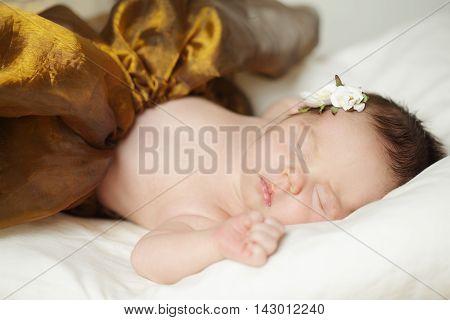 Sleeping beautiful baby girl newborn on light
